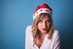 Girl wearing Santa clause hat Stock Images