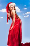 Girl wearing santa clothes with champagne glass Stock Photo
