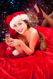 Girl wearing santa clothes with champagne glass Stock Image