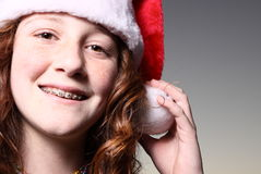 Girl wearing a Santa Hat stock image