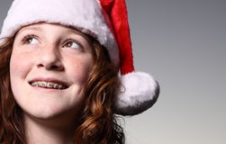 Girl wearing a Santa Hat Royalty Free Stock Photography