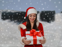 Girl wearing a Santa hat with Christmas git Royalty Free Stock Photo