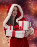 Girl wearing a Santa hat with Christmas git Royalty Free Stock Image