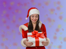 Girl wearing a Santa hat with Christmas git Stock Photos