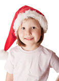 Girl wearing Santa hat. Little girl wearing Christmas Santa hat looking at the camera and smiling Stock Photography