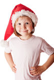 Girl wearing Santa hat. Little girl wearing Christmas Santa hat looking at the camera and smiling Royalty Free Stock Photo