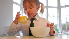 Girl Wearing School Uniform Eating Breakfast Cereal stock video footage