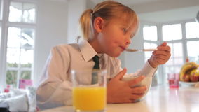 Girl Wearing School Uniform Eating Breakfast Cereal stock video