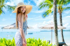 Girl wearing a sea cap standing on the beach Royalty Free Stock Photo