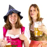 Girl wearing Seppelhut with mother at Oktoberfest Stock Photo