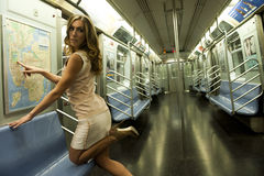Girl wearing a short dress pointing to the subway map Stock Photo