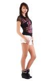Girl wearing shorts Stock Photos