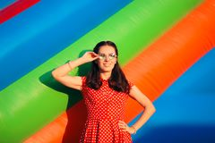 Retro Woman at Garden Party Near Bouncy House Royalty Free Stock Photos
