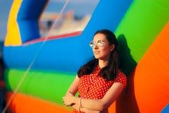 Retro Woman at Garden Party Near Bouncy House Stock Photo