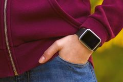 Girl wearing smart-watch on her hand Stock Photos