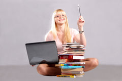 The girl wearing spectacles and with a pencil stock image