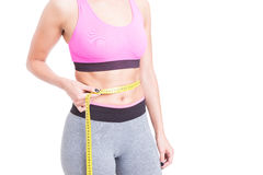 Girl wearing sportswear measuring her waist Royalty Free Stock Photography