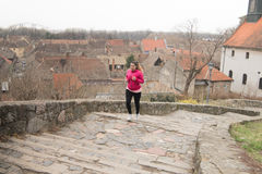 Girl wearing sportswear and running upstairs at city fortress Royalty Free Stock Photo
