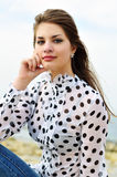 Girl wearing spotted blouse Stock Photos