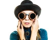 Girl wearing steampunk hat. Stock Image