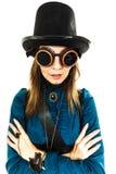 Girl wearing steampunk hat. Royalty Free Stock Photos