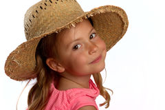 Girl wearing a straw hat Stock Photo