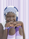 Girl wearing a striped headscarf, ten years old Stock Photo