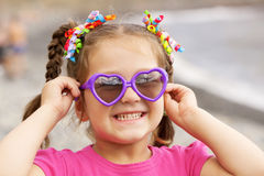 Girl wearing a sunglasses on the beach. Royalty Free Stock Images