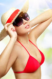 Girl wearing sunglasses on a light background Royalty Free Stock Image