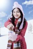 Girl wearing sweater and holding piggybank Stock Photos