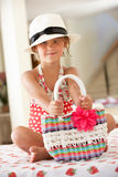 Girl Wearing Swimming Costume And Straw Hat. Girl Wearing Swimming Costume With Straw Hat And Bag Royalty Free Stock Photography
