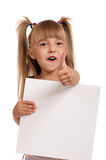 Girl wearing swimsuit. Little beautiful girl wearing pink swimsuit holding empty white board isolated on white background Stock Image