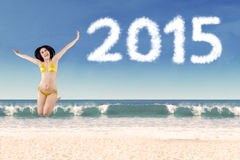 Girl wearing swimsuit in new year holiday Royalty Free Stock Photos