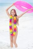 Girl is wearing swimsuit with pink rubber ring at Royalty Free Stock Images
