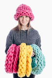 Girl wearing a thick scarf and hat Stock Photos