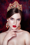 Girl wearing tiara and sparkling jewlery. Vogue style royalty free stock photo