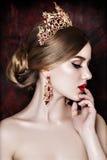 Girl wearing tiara and sparkling jewlery. Vogue style stock image