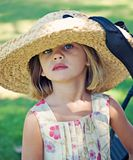 Girl Wearing Too Big Hat Stock Image