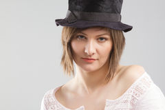 Girl wearing  top hat Royalty Free Stock Image