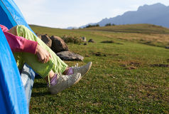 Girl wearing trainers. In the mountains Stock Photo