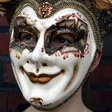 Girl wearing a venetian carnival mask normal gaze. This is a girl wearing a venetian carnival mask showing a normal gaze (close-up version Royalty Free Stock Photography