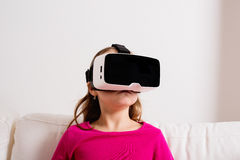 Girl wearing virtual reality goggles. Studio shot, copy space Stock Photos