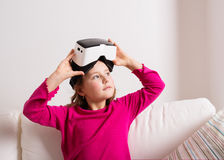 Girl wearing virtual reality goggles. Studio shot, copy space Stock Images