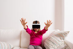 Girl wearing virtual reality goggles. Studio shot, copy space Royalty Free Stock Images