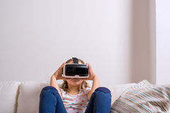 Girl wearing virtual reality goggles. Studio shot, copy space Royalty Free Stock Image