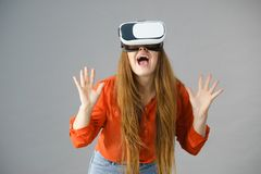 Girl wearing virtual reality goggles. stock images