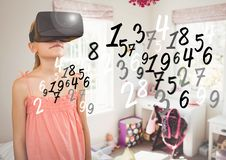 Girl wearing virtual reality headset at home Stock Photos
