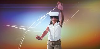 Girl wearing virtual reality simulator. Against white background stock photo
