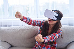 Girl wearing VR glasses driving car in virtual reality Stock Photos