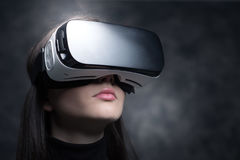 Girl wearing a VR headset Stock Photo